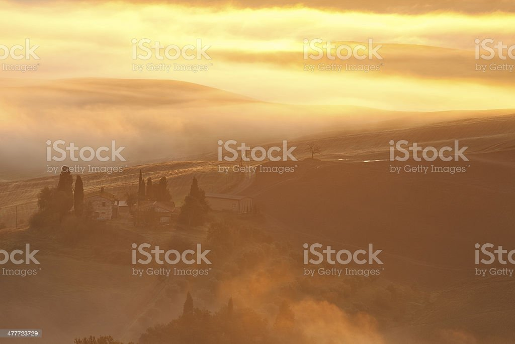 Morning Fog at Sunrise in Tuscany royalty-free stock photo