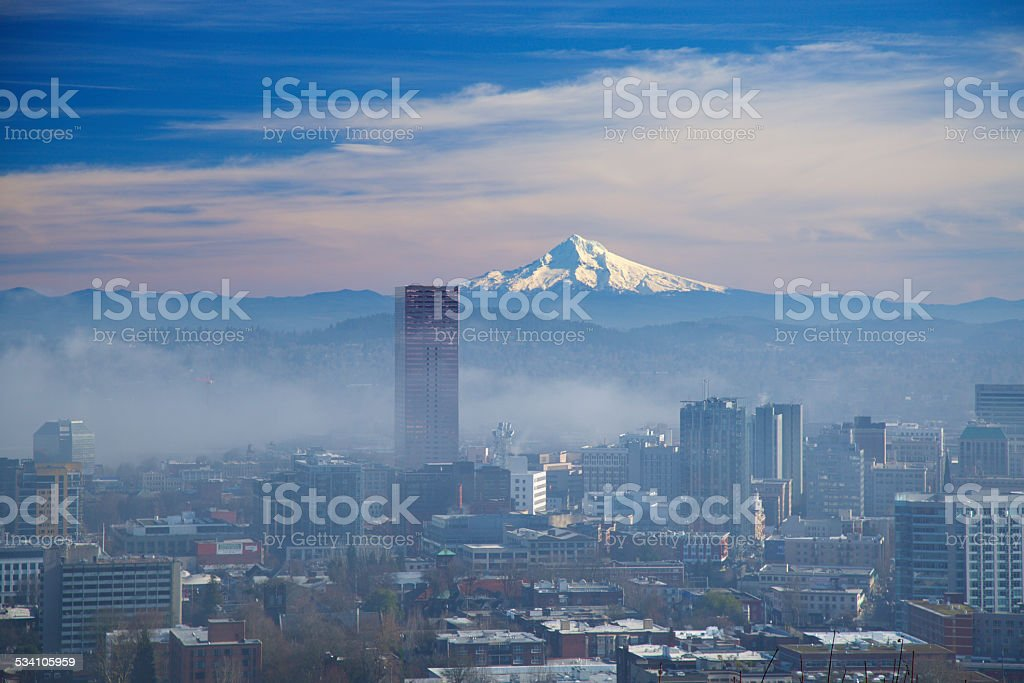 Morning fog clearing out in downtown portland stock photo
