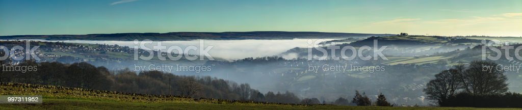 Morning Fog Covering West Yorkshire Valleys - Aerial Panorama stock photo