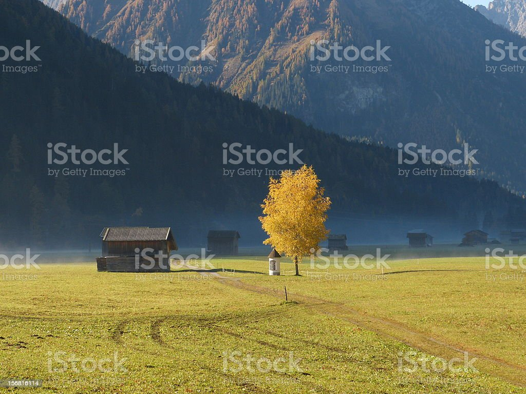 Morning fog in the autumn mountains stock photo