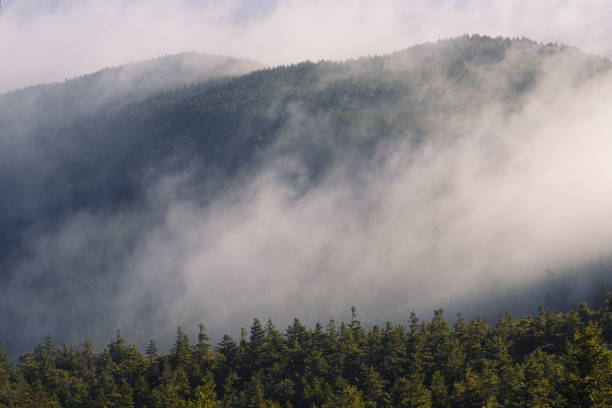 Morning fog on Mount Monadnock in Jaffrey New Hampshire stock photo