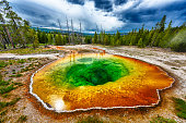 Morning glory pool from above. Stormy weather. Yellowstone National Park, Wyoming, USA