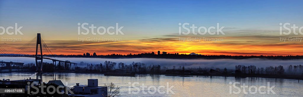 Morning glow with fog along riverbank (panoramic view) stock photo
