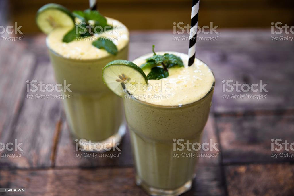 Morning breakfast smoothie drink made of super foods, fruits, mint....