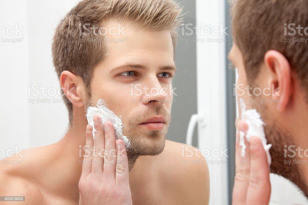 Morning hygiene in the bathroom stock photo