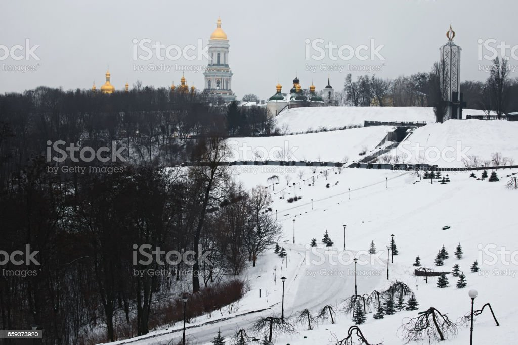 Morning in city. View to the National Museum 'Memorial to Holodomor victims' and Great Lavra Bell Tower from Park Vіchnoї Slavi.  Winter landscape. Kyiv. Ukraine stock photo