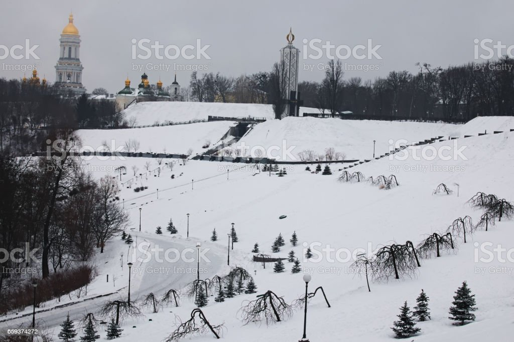 Morning in city. View to the National Museum 'Memorial to Holodomor victims' and Great Lavra Bell Tower. Winter landscape. Kyiv. Ukraine stock photo