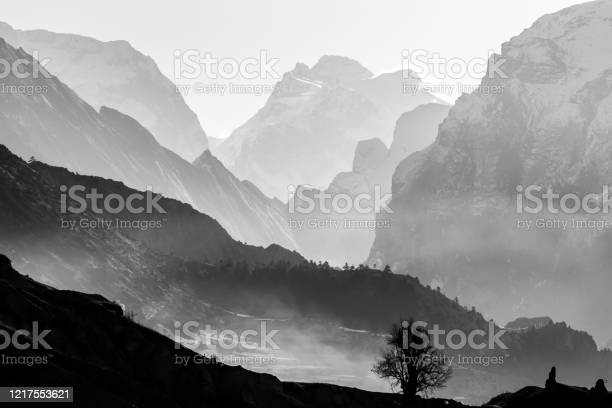 Photo of Morning in foggy mountains. Black and white mountain background