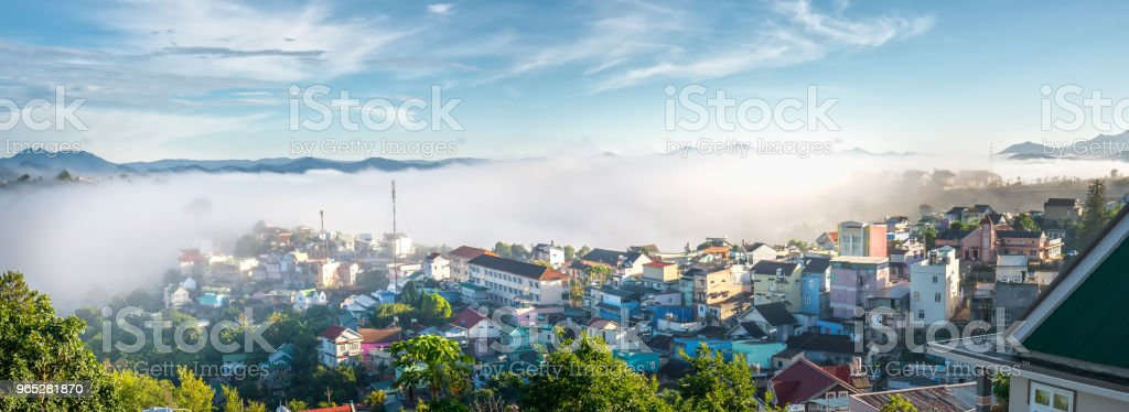 Morning in small town on the plateau fog covered houses royalty-free stock photo