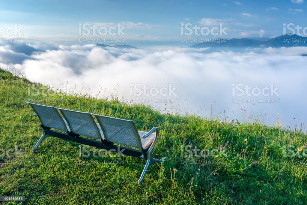 Morning in the mountains above the clouds stock photo