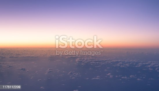 Beautiful sunrise above the clouds taken from airplane.