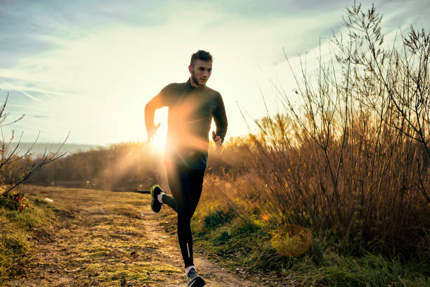 morning jogging - jogging stock pictures, royalty-free photos & images
