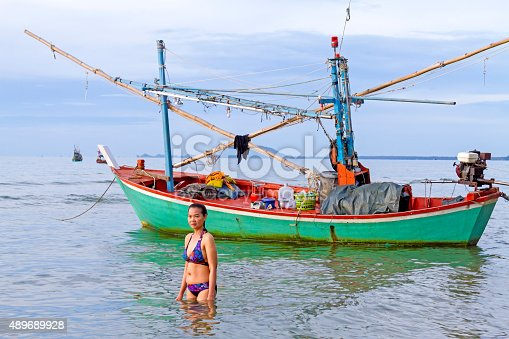 494377786istockphoto Morning lady and boat 489689928