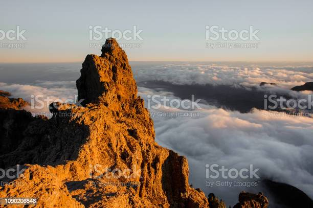 Photo of GRAN CANARIA, SPAIN - NOVEMBER 6, 2018: Morning landscape of Roque Nublo mountain under the sunlight among clouds under the sky