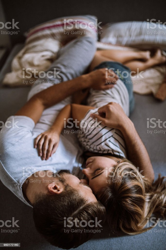 Morning Laziness With Cuddles And Kisses Stock Photo