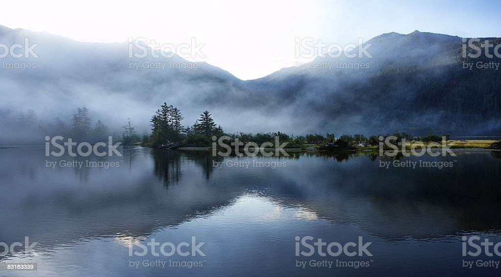 Morning light  and mist across sound and mountains royaltyfri bildbanksbilder