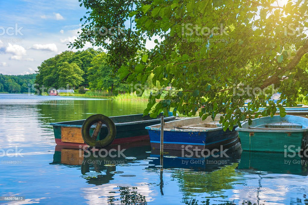 Morning light at a lake in Mecklenburg with jetty stock photo