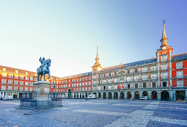 morning light at plaza mayor in madrid , spain - madrid stok fotoğraflar ve resimler