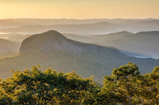 Morning light over Looking Glass Rock, North Carolina. stock photo