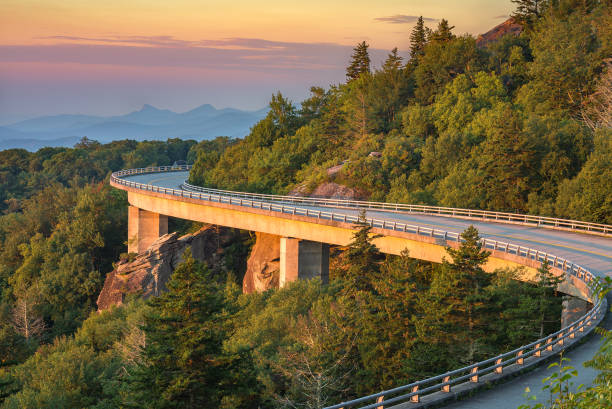 Morning light over viaduct, Blue Ridge Parkway morning light spills out on the Lynn Cove viaduct along the Blue Ridge Parkway in North Carolina. appalachia stock pictures, royalty-free photos & images