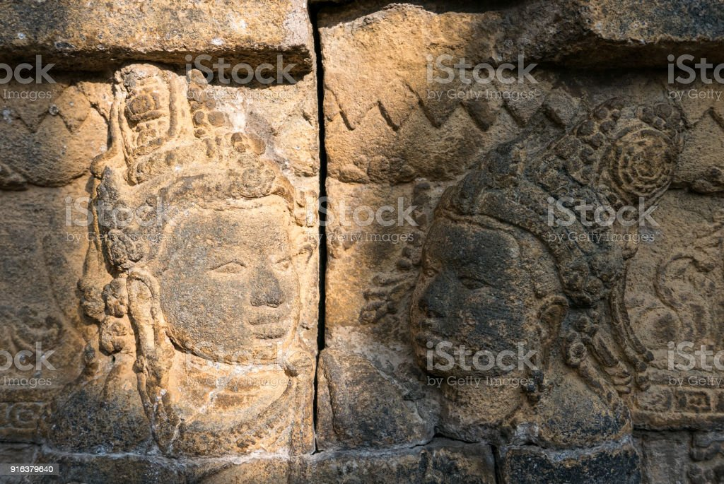 Morning light shines on a relief carving candi borobudur java