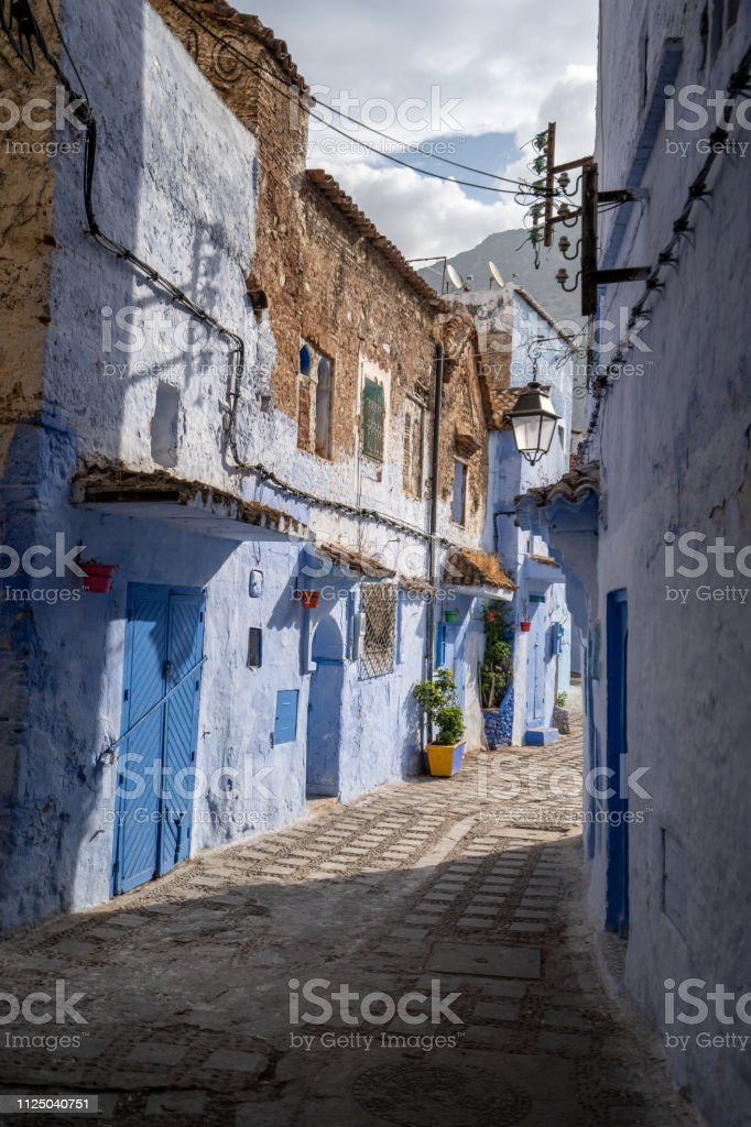 Morning lights are bringing out the blue color of the streets of Chefchaouen, Morocco stock photo