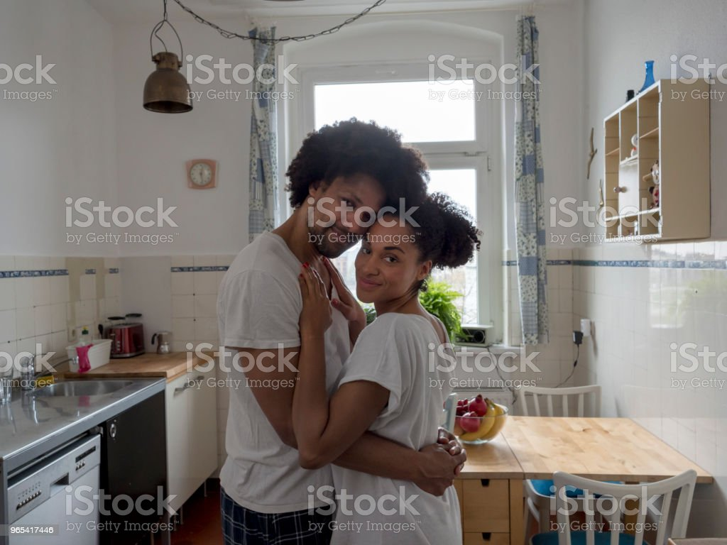 Morning love, couple in kitchen zbiór zdjęć royalty-free