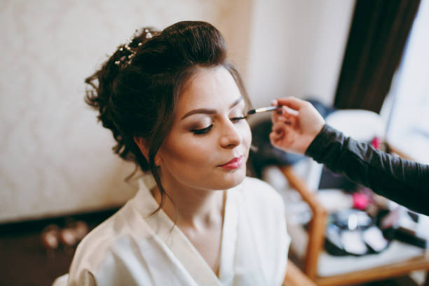 morning make-up in the room for a beautiful bride - bride stock photos and pictures