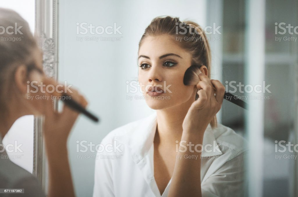 Morning makeup routine. stock photo