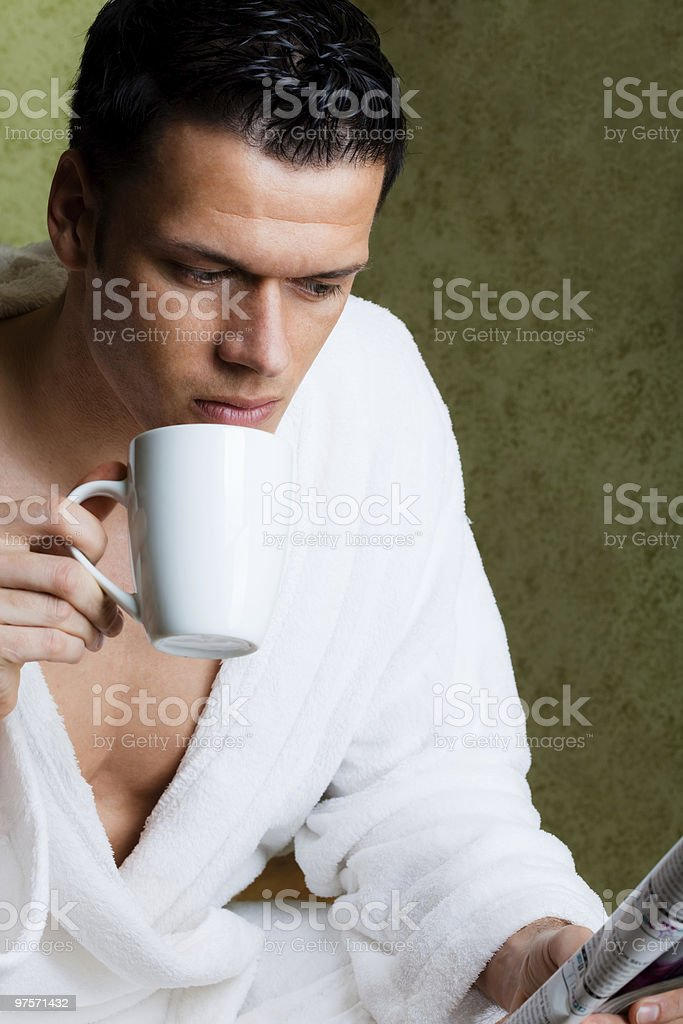 morning man with cup and newspaper royalty-free stock photo