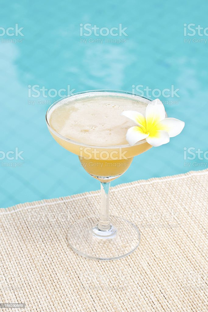 Morning Margarita cocktail near waterpool on the mat royalty-free stock photo