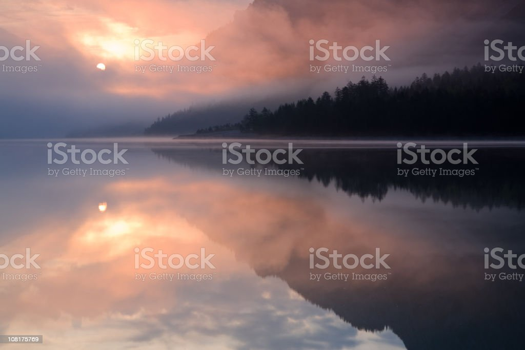 morning mist at lake plansee royalty-free stock photo