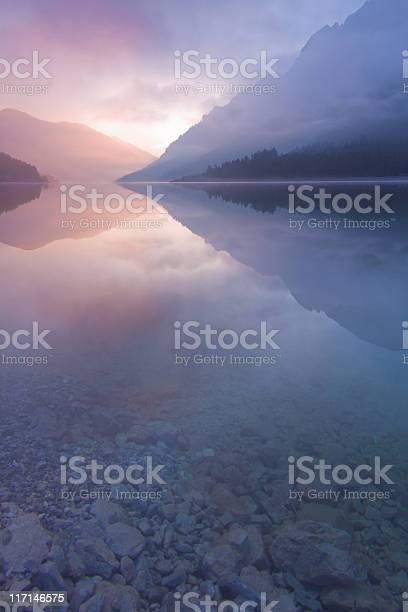 Photo of morning mist at lake plansee, tirol, austria, vertical