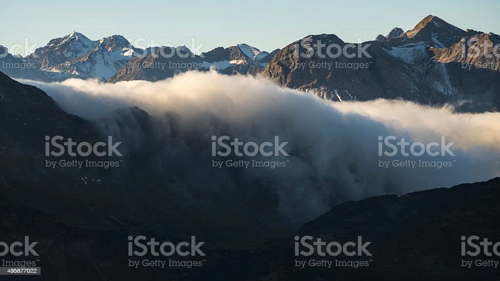 Morning mist flowing into the valley stock photo