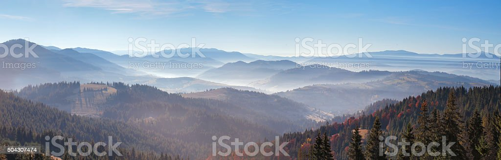 Morning mist in mountains. Sunrise and autumn mist over hill stock photo