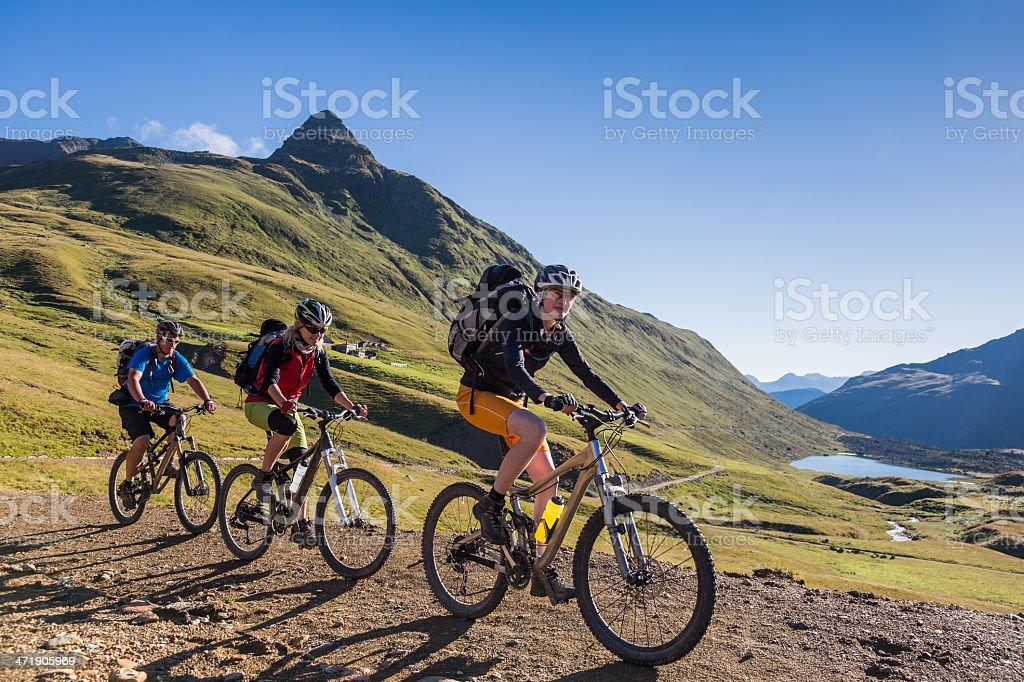 Morning mountainbiking in the Lombardian Alps, Italy stock photo