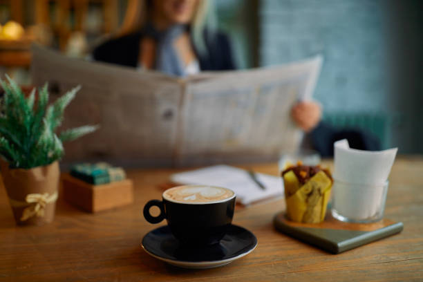 Morning news and cup of coffee stock photo