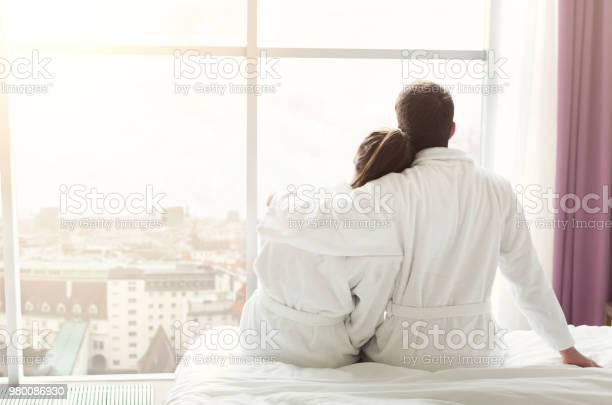 Morning of happy young couple resting in hotel room picture id980086930?b=1&k=6&m=980086930&s=612x612&h=k2moiejdocrcbycmk9t7qgnorkhivoj8iyn4hxa2u1y=