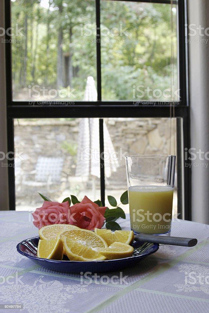 Morning orange juice and roses royalty-free stock photo