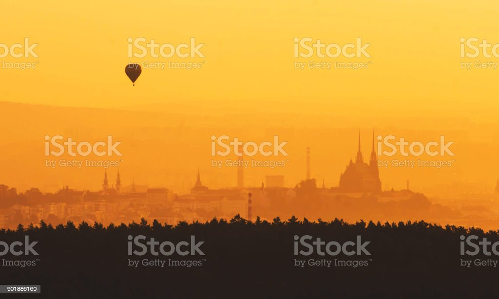 Morning over Brno - Czech Republic, Sunset over the City, Silhouette of Cathedral Petrov and hot air balloon stock photo