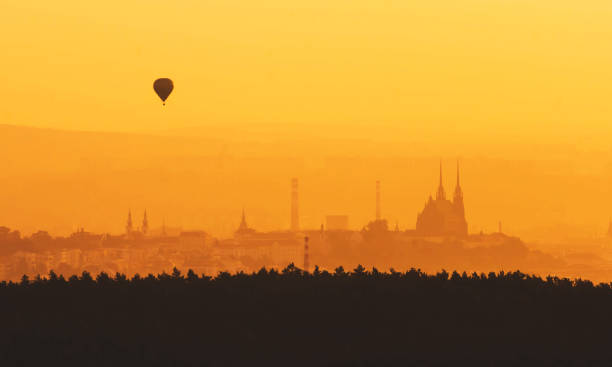 Morning over Brno - Czech Republic, Sunset over the City, Silhouette of Cathedral Petrov and hot air balloon Morning over Brno - Czech Republic, Sunset over the City, Silhouette of Cathedral Petrov and hot air balloon brno stock pictures, royalty-free photos & images