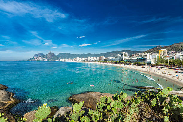 Morning panorama of Ipanema Beach in Rio de Janeiro Morning sun on Ipanema Beach with city panorama in Rio de Janeiro,Brazil lagoa rio de janeiro stock pictures, royalty-free photos & images