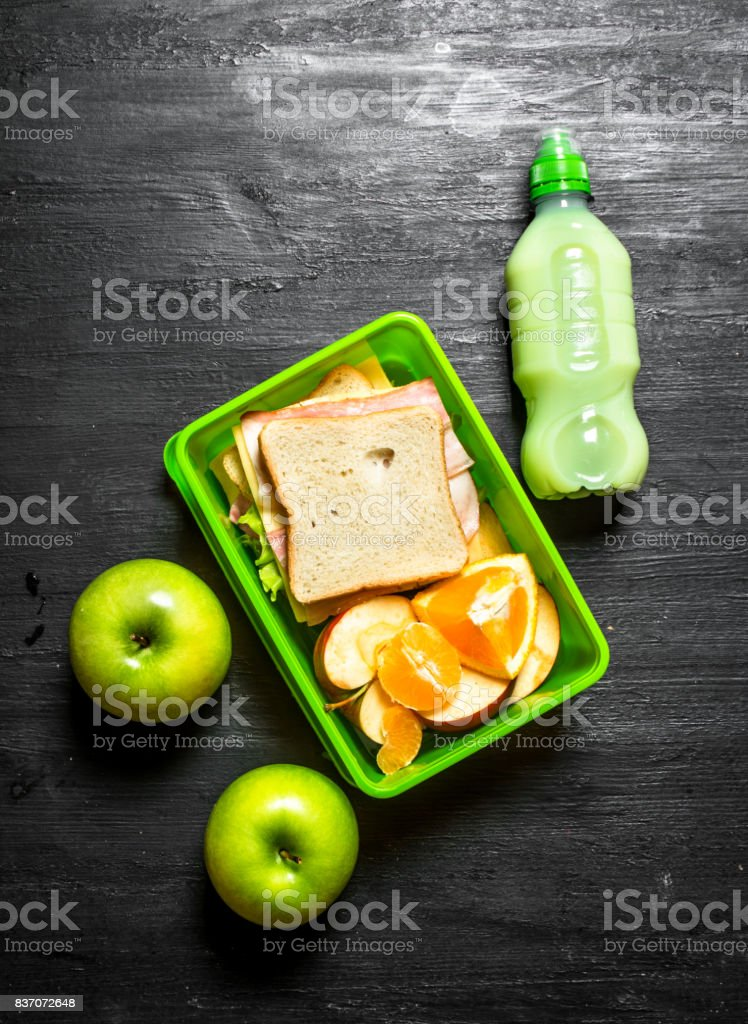 Morning picnic. Sandwiches milkshake and fruit. stock photo