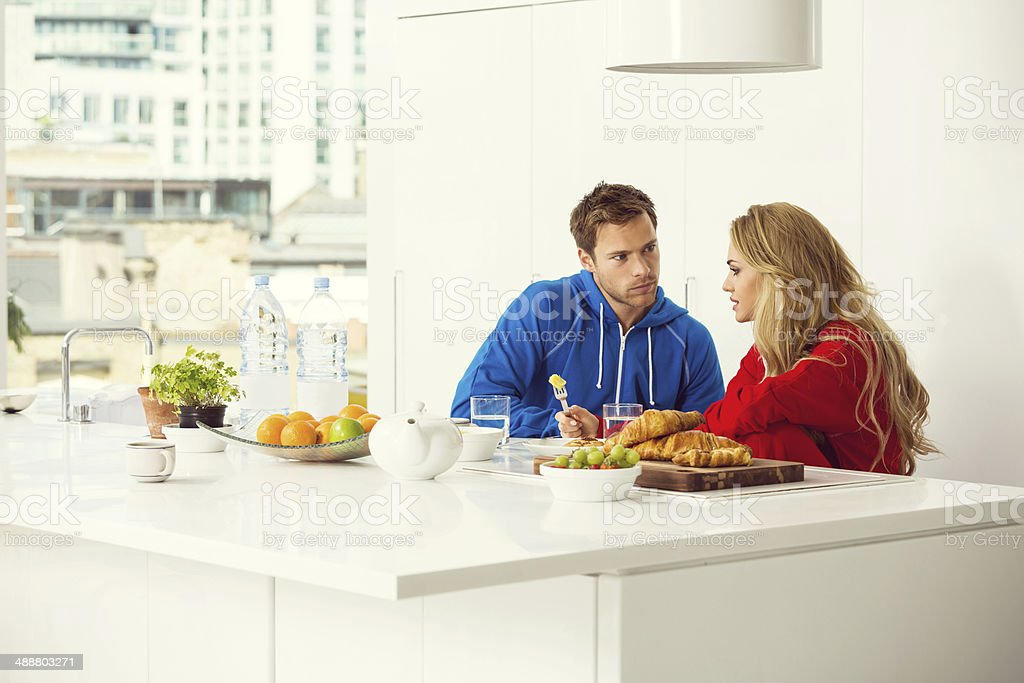 Morning Young couple sitting in the modern kitchen in the morning and having breakfast.  20-24 Years Stock Photo