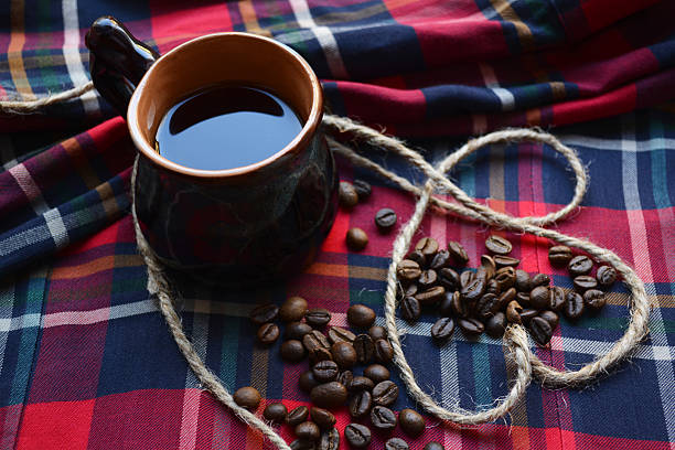 morning morning on Valentine's day. Valentine, Cup of coffee on a checkered tablecloth and a heart of harness devolve stock pictures, royalty-free photos & images