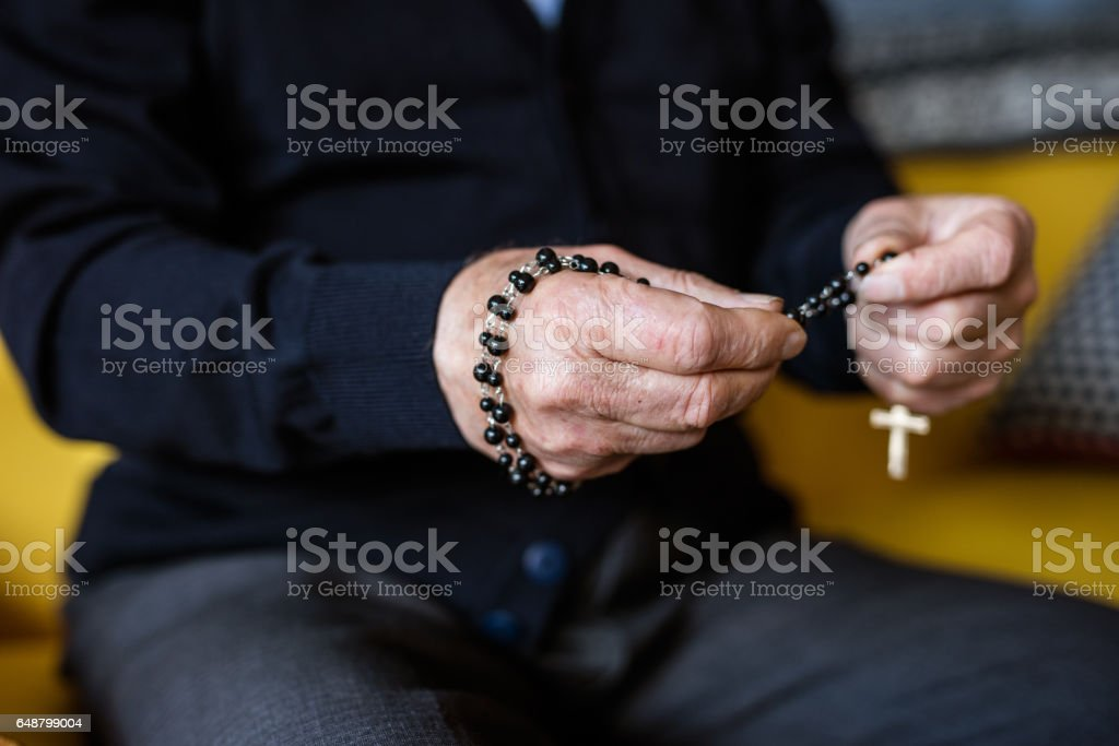Morning prayer of old man, close up on hands stock photo