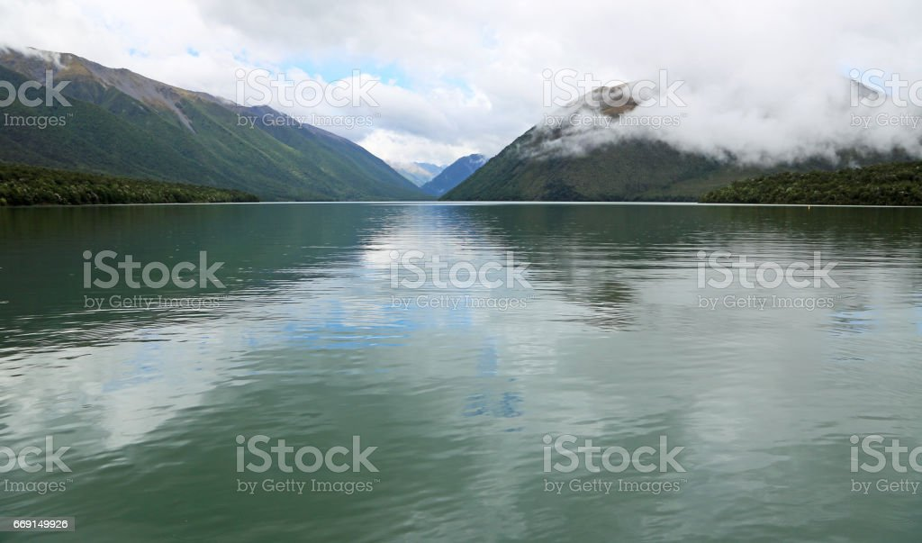 Morning rain on Rotoiti Lake stock photo