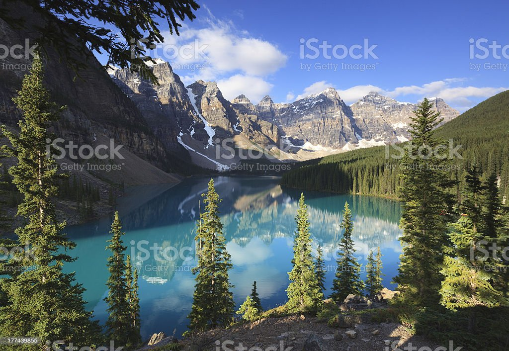 Morning reflections at Moraine Lake in Canada stock photo