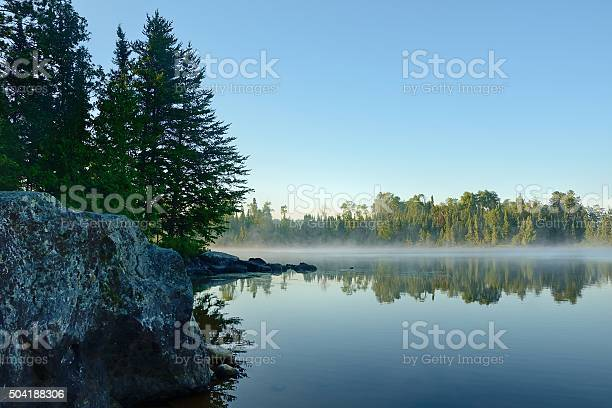 Photo of Morning Reflections on a Foggy Wilderness Lake