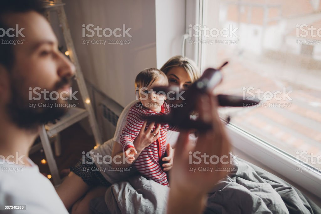 Morning routine with our baby boy stock photo